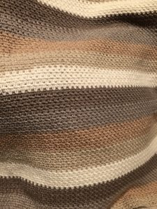 Close up of the moss stitch blanket